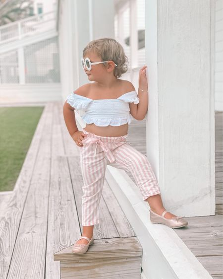 she IS the moment. 😎  Flower sunnies from 30A Mama online shop.   two piece toddler set linked here. We have the turquoise and pink and white. So cute! Perfect for a beach trip or vacay. http://liketk.it/3jmex #liketkit @liketoknow.it #LTKkids #LTKfamily #LTKtravel