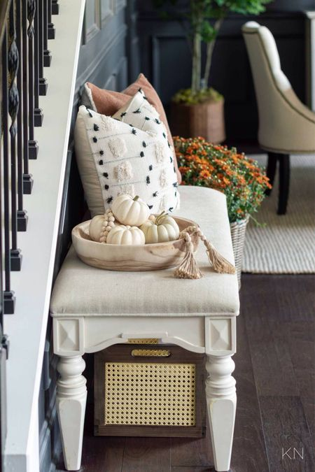 My fall decor touches have begun in my entryway! Home decor padded bench fall pillows storage basket dining room decor  #LTKhome #LTKstyletip #LTKSeasonal