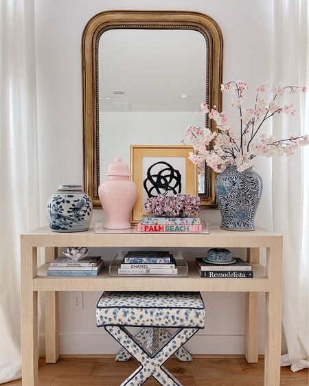 Do you have a blank wall in your home and don't know what to do with it? A console table is the perfect way to create a decor moment while also being functional. Hang a mirror or art above and use trays and bowls to showcase items from your travels or pieces you want to enjoy seeing everyday (I'm a huge fan of blue & white so you'll see ginger jars throughout our home!) Console tables are also a great way to display some of your favorite books. This raffia console gives our space a great dose of coastal warmth and texture. Shop this vignette by following me, @veronabrit I'm the LIKEtoKNOW.it app! http://liketk.it/3fhnM #liketkit @liketoknow.it #LTKhome @liketoknow.it.home