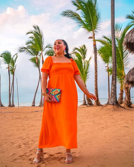 The perfect smocked vacation dress! Love this orange dress, but it also comes in several other colors like pink and purple. Wearing a size L! Shop here: http://liketk.it/3hHZQ @liketoknow.it #liketkit #LTKunder100 #LTKunder50 #LTKtravel
