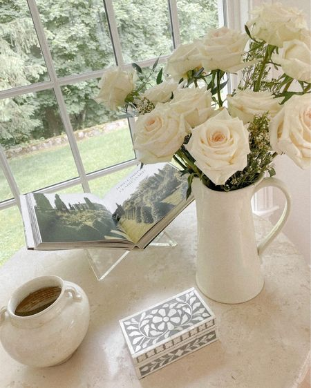 Accent table with book stand and vases. http://liketk.it/3hFT3 #liketkit @liketoknow.it #LTKstyletip #LTKhome