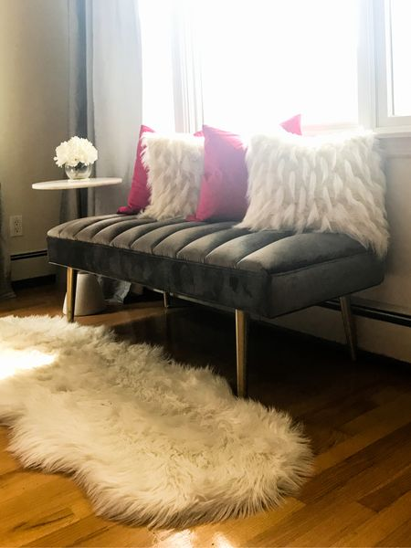 Fall living room decor update complete with fur rug, velvet tufted bench and marble side table.   Velvet pillow, fur pillows, marble and gold side table, living room, living room decor, modern side table, living room furniture   Follow me on the LIKEtoKNOW.it app for furniture and decor ideas.     #LTKhome #LTKHoliday #LTKstyletip