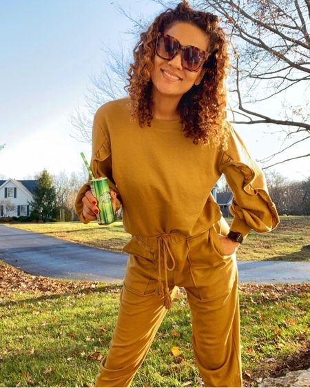 Thrilled over this mustard set with the ruched lateral sleeve detail! I got it in both colors 💕 The joggers are also super cute although I wish they were longer, but #tallgirlproblems.  The sunnies 🕶 complete the look and I'm here for it with ny sparkling water because all day sickness is real! #liketkit #StayHomeWithLTK #LTKtravel #LTKunder50    You can instantly shop all of my looks by following me on the LIKEtoKNOW.it shopping app and @liketoknow.it via this link 👉🏼 http://liketk.it/33bUs