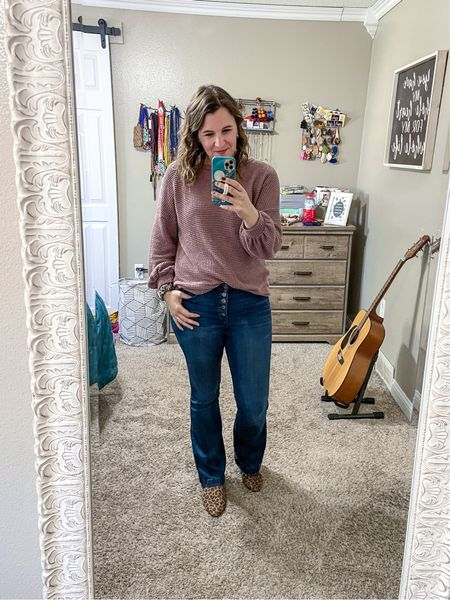 An easy fall look! This thermal blouse has some feminine details that make it great for dressing up or down. Paired with some flares and a front tuck, you're set! And of course I had to add a pop of leopard with my mules and watch band.   #LTKSeasonal #LTKunder50