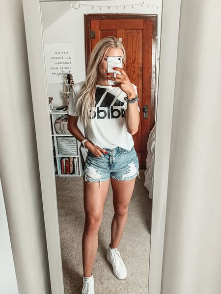 One of my go-to summer styles - a graphic tee, distressed denim, and white sneakers🙌  These American Eagle shorts are last season but I'll link similar options that are in stock now! I wear this adidas trefoil tee and these platform sneakers from adidas all the time 👏