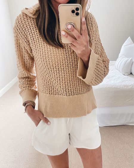 Open knit hoodie wears well over a swimsuit now or a cami in the fall.  Wearing xs.  It's a Walmart find.  Xs shorts.  @liketoknow.it #liketkit http://liketk.it/3i1zh #LTKunder50 #LTKstyletip #LTKsalealert