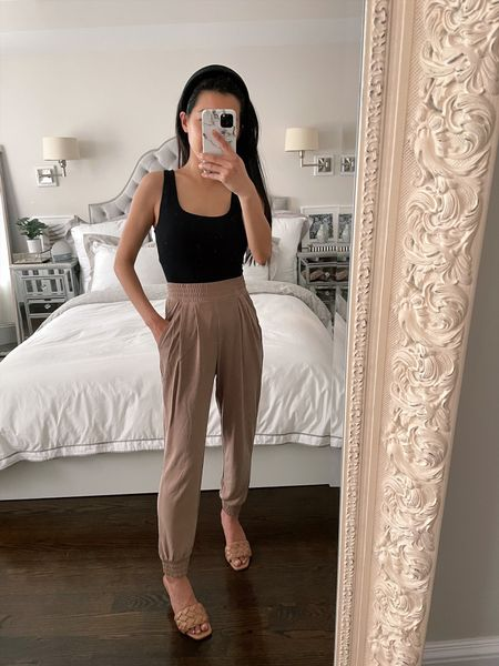"""Versatile spring style // my square neck tank (xxs) is on sale for $20! It's a slimming body contour top with a good amount of """"hold"""", comes in 7 colors, and is perfect for tucking into high waisted pants or skirts. These sueded jersey high waisted joggers (xxs) come in 6 colors and are lightweight, comfortable and perfect for dressing up or down. Love these on trend woven / quilted sandals! (Wearing size 6) The insoles and strap are cushy and padded and they're a great look-for-less designer sandal. Available in 3 colors: black, white and this pecan tan color  #LTKSeasonal #LTKunder100 #LTKshoecrush"""