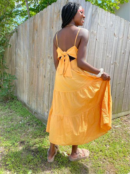 Casual beach dress for summer vacation! Orange tiered tie back dress and fuzzy sandals.   #LTKtravel #LTKunder50 #LTKunder100