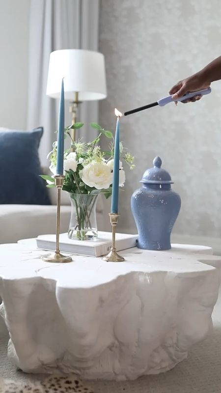 Style your coffee table with ease by adding some taper candles, a large book and some flowers.  #homedecor #livingroom #bedroom   #LTKSeasonal #LTKhome