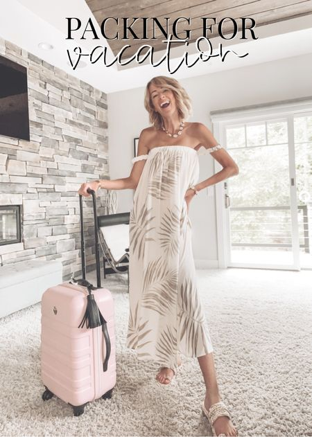 Packing for a beach vacation Maxi dress Bikini and coverup coola sunscreen Suitcase organized packing   #LTKswim #LTKstyletip #LTKtravel