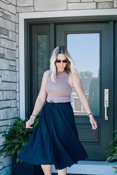 The best pleated midi skirt! So light weight and performance material. It will travel so well! Runs a little generous, tie waist to adjust size.   Athleta skirt, travel skirt    #LTKtravel #LTKstyletip #LTKunder100