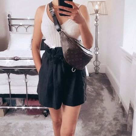 Styling my Louis Vuitton bumbag as a crossbody with a neutral crop top and tie bag shorts.   Wear with sandals for everyday and heels for a casual / dressy look 🙌  Top size XS & shorts size Small.   #LTKstyletip #LTKshoecrush #LTKsalealert