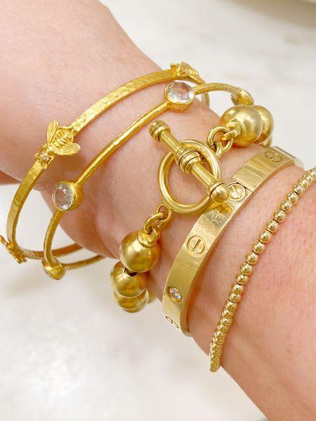 Favorite bracelet stack. Love these gold beaded bracelets paired with the bee bangle and other gold bangles.   #LTKstyletip #LTKsalealert #LTKunder100