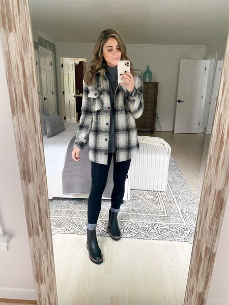 Chelsea boots styled with leggings, an oversized sweater, and a shacket.