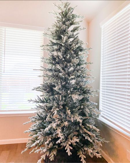 9 ft pre-lit flocked Christmas tree from Target - gorgeous tree! Even prettier in person!   So easy to put together too.        Christmas trees , Christmas decor , holiday decor , flocked tree , target finds , target style , target Christmas , pre-lit Christmas tree    #LTKHoliday #LTKSeasonal #LTKhome