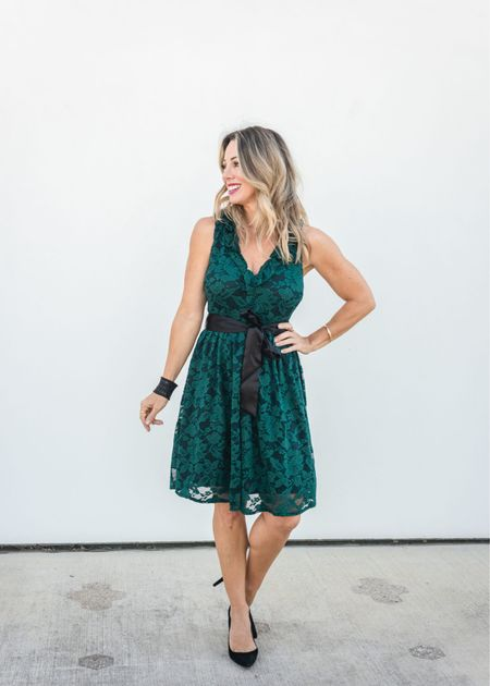 Not only is it stunning with the gorgeous emerald green lace and black lining, there's a flirty ruffled v-neck and detachable black satin tie belt.  Dress Fit: I'm wearing an XXS   #LTKshoecrush #LTKstyletip #LTKHoliday
