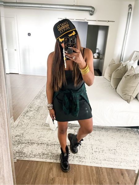 Love this Abercrombie and Fitch dress I paired it with my Black boots #AthleticDress #Dress #TruckerHat #boots #Combatboots #plaid #Athleticwear