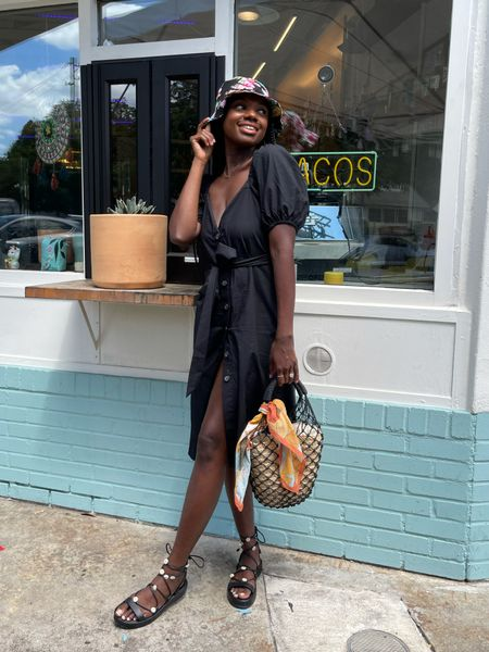 Black puff sleeve button down dress with belt, black net straw purse, and black and floral platform lace up sandals.   #LTKunder100 #LTKstyletip #LTKDay