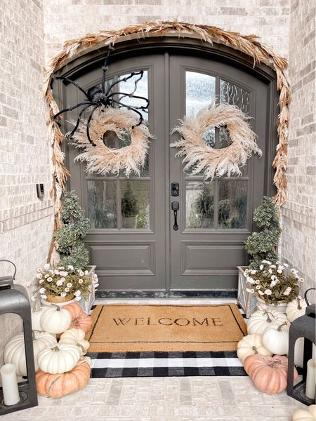 Front door decor, front porch, fall Decor, doormat, lantern, plaid rug, garland, wreath, pumpkin   #LTKhome #LTKSeasonal #LTKHoliday