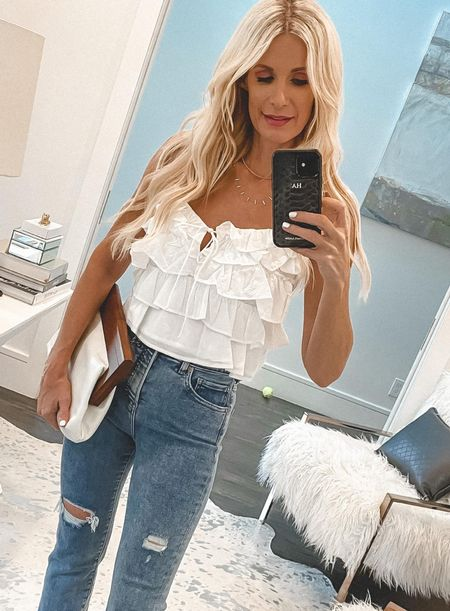 Easy breezy under $50 summer top! Jeans, bag, and shoes are also under $100! Wearing an XS in the top and a 0 reg in the jeans.  Follow my shop on the @shop.LTK app to shop this post and get my exclusive app-only content!  #liketkit #LTKstyletip #LTKunder50 #LTKunder100 @shop.ltk http://liketk.it/3kqC8