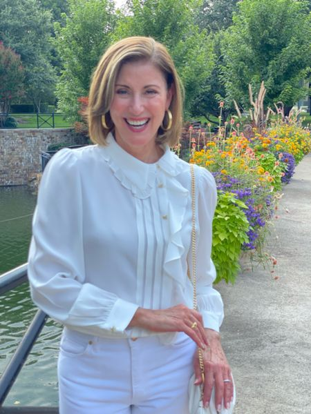 I'm in love with this gorgeous ruffle front blouse from @bashparis. Such chic details like the cross-shaped rhinestone buttons. It's so versatile you can wear it with jeans or a dressy pant for evening. I believe you can never have too many white blouses in your wardrobe. #fallcollection #whiteblouse #ruffles   #LTKstyletip