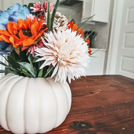 I am all for an easy diy project! This fall table decor is the perfect addition to your fall decor, and easy to create!  #falldecor #homedecor #fallflowers #fallhome #tablescape #michaels   #LTKunder50 #LTKSeasonal #LTKhome
