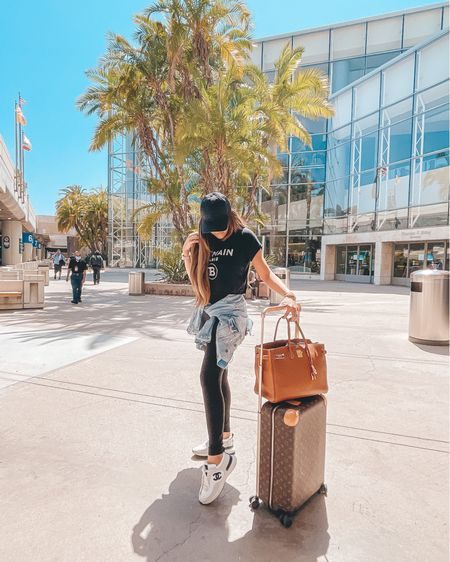 http://liketk.it/3f455 #liketkit @liketoknow.it #LTKtravel airport travel outfits, casual sneaks, Chanel sneakers, best black baseball caps, what to wear on an airplane, airplane outfits, Emily Ann Gemma, best leggings 2021, black leggings, flattering leggings