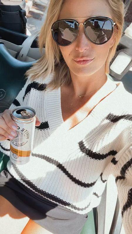 Striped cozy sweater and lululemon skirt for golf 🤍✔️   #LTKfit #LTKunder100 #LTKstyletip