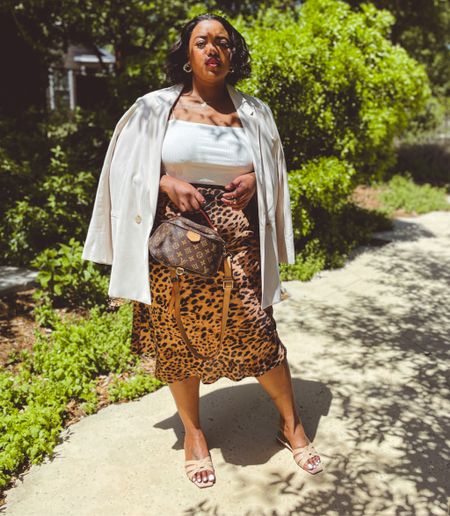 Y'all KNOW I love my plus size midi skirts - they're perfect for every season, can be dressed up and dressed down, and they go with everything. And FYI, leopard is a neutral, sis.  I was hella excited to find a dupe of my all-time favourite skirt from Forever21, in sizes 1x-4x, on sale for under $20!  It's the perfect plus size summer outfit builder, and we love the extended sizing being rolled out at F21!  #LTKsalealert #LTKcurves #LTKunder50