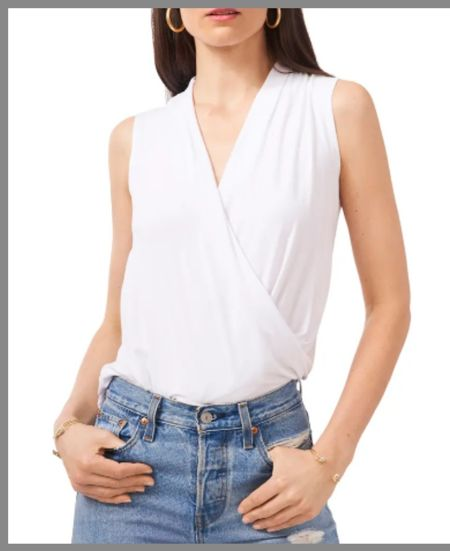 White dressy tank top in the Nordstrom anniversary sale. The crossed front it gives a dressy look while having the coolness of wearing a tank top. The soft material makes it a cozy fit for summer or layering in the winter. . . sleeveless top, tank top dressy light top