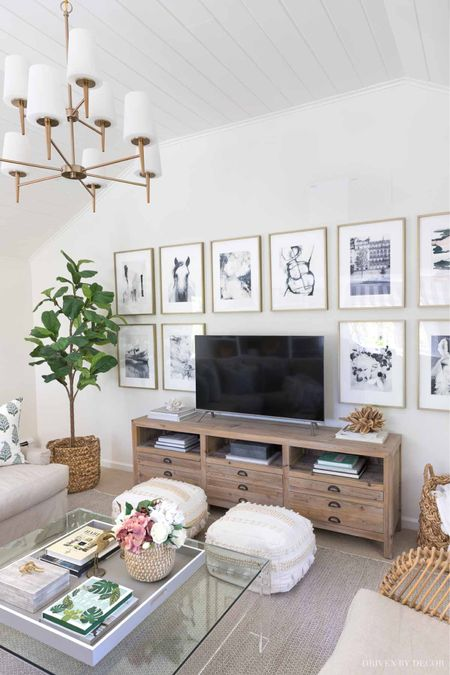 Our living room is our favorite spot to hang out as a family! Media cabinet, faux fiddle leaf fig tree, poufs, rug, pillows and more. (home decor ideas) #LTKDay  #LTKunder50 #LTKunder100