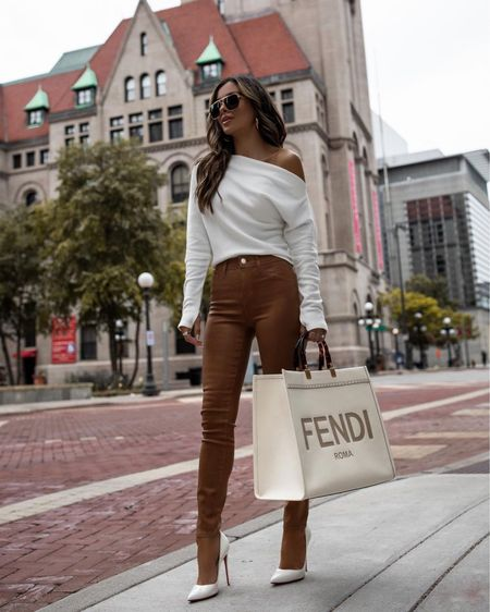 Revolve casual outfit ideas  Camel coated denim wearing a 23 Free People white thermal top Fendi sunshine tote   #LTKitbag #LTKstyletip #LTKunder100