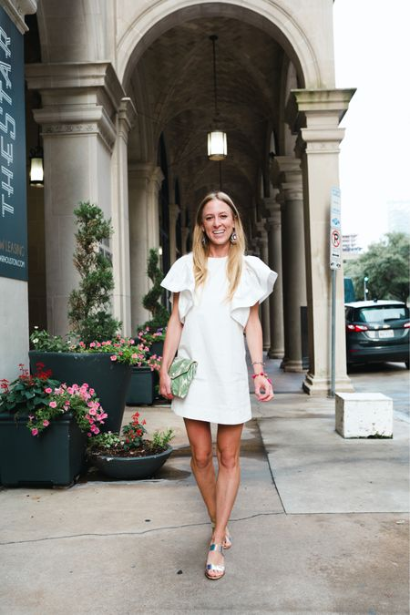 White shift dress with puffy sleeves - perfect for bride / wedding week and summer outfits. Tagged a few similar options along with a green palm leaf clutch and statement rainbow bead earrings   #LTKtravel #LTKunder50 #LTKwedding