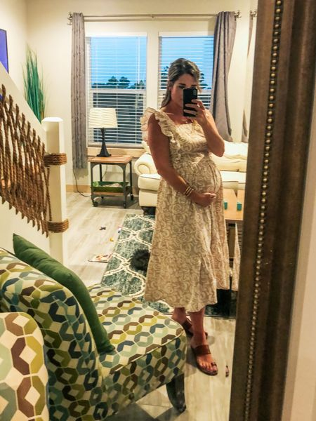 Bumpin' and ready for beach pics. Tan floral dress under $20 🙌🏻 Non maternity, but also works with a bump 💕  #LTKbump #LTKstyletip #LTKunder50