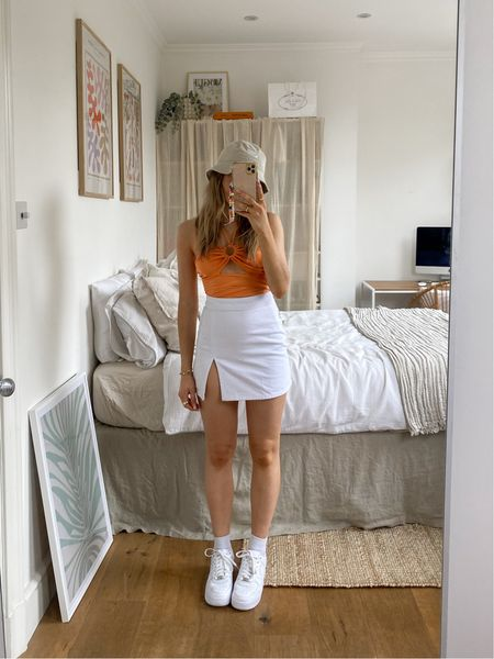 This festival look is perfect for those warm summer days   I love this orange bodysuit teamed with this white denim skirt for a summery festival vibe     #LTKeurope
