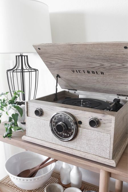 A new apartment favorite: this beautiful vintage inspired natural wood turntable! And it's under $100  Apartment decor, home decor, record player, contemporary decor, living room, dining room, serving bowls, lamp   #LTKhome #LTKunder100