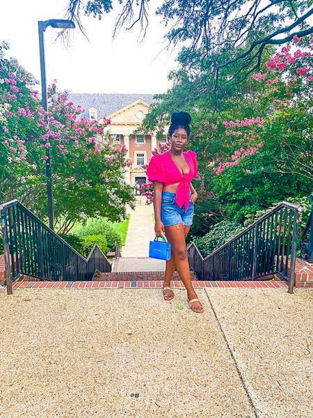 This pretty pink tie crop top is a summer must for dressing up or down. Linking my cutoff mom shorts and similar Brandon Blackwood mini bags for you, too!  #LTKtravel #LTKunder50