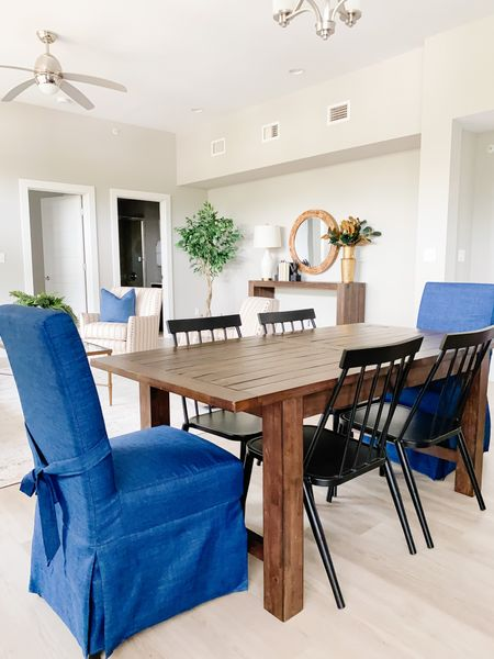 Pop of blue upholstered chairs with the black metal chairs in the dining set.  Dining chairs, dining table, dining room decor, home decor, wood table, skirted dining chair  #LTKhome
