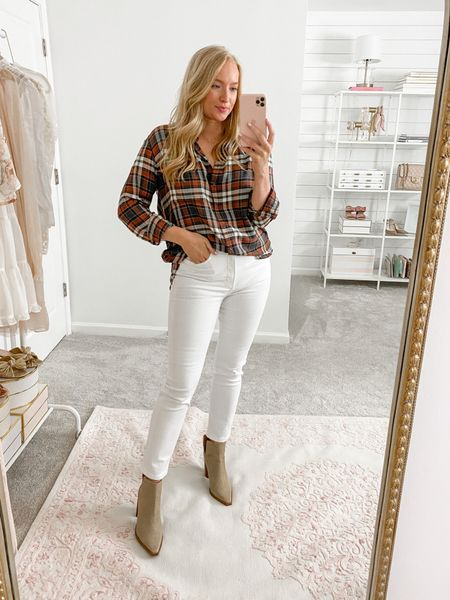 White jeans with a fall plaid flannel and booties