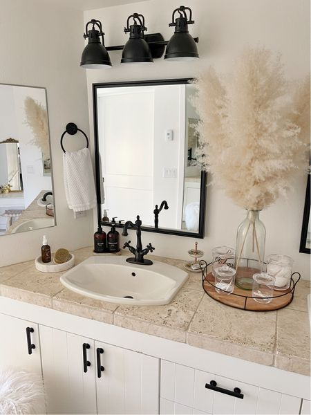 H O M E \ Good morning, y'all! Starting the day with my skincare routine and a CLEAN bathroom🙌🏻  Added a few new items to this space👉🏻 hand & lotion bottles, textured hand towels, a marble tray and skin brush! I'm allllll about exfoliating my face AND body🙋🏻♀️ Get the dead skin OFF! My updated skincare is on SBKliving.com including my daily routines and body items I love to use👌🏻  If you're wondering about Luke's side, he still hasn't put away his toiletries since our last airstream trip🤯 I mean, I just don't get it!! I thought maybe it would be a week of his shit still sitting in his travel bag… but NO, it's been months😂😂 Just threw it in the medicine cabinet - k byeeeee👋🏻👋🏻👋🏻  Sharing the before & after of this space on the blog! We did cosmetic things that made ALL the difference. Shop my bathroom on the LTK app - link in bio!  #bathroom #bathroomdecor #farmhouse #homedecor   #LTKhome #LTKunder50