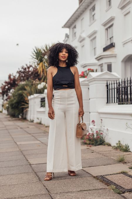 Monochrome black and white outfit - black top and white high waisted trousers. Mango highwaisted trousers.   #LTKstyletip #LTKSeasonal #LTKeurope