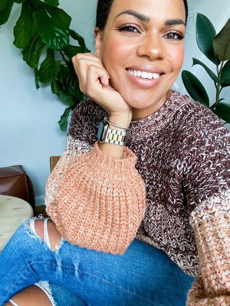 Yarn ballon sleeve sweater, jeans, earrings, watch band