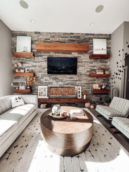 DIY fireplace cover Rustics wood art piece  Living room decor Rug Round coffee table  Halloween decor    #LTKHoliday #LTKSeasonal #LTKhome