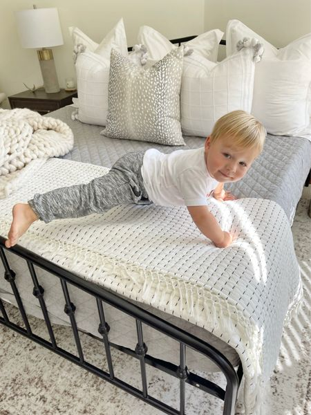 """F O R D \ Our 22 mo old is weighing in at 36 lbs and officially a monkey🐒 Climbing on EVERYTHING!🤪 The guest bed has become his new favorite """"jungle gym""""😂 I'm pretty sure he may love cozy things and pillows as much as me! Are there enough on this bed?? I think so!🙋🏻♀️😜 It's  all about the insert - sharing my tips and tricks VIDEO on stories today!   #babyboy #cozyhome #bedroom #bedding #pillows    #LTKhome #LTKfamily"""