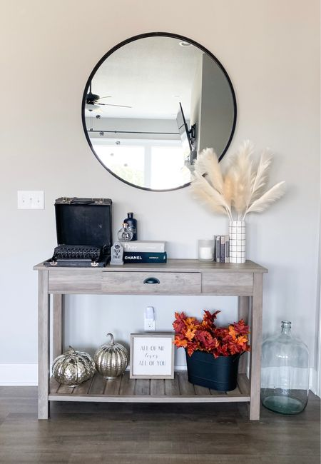 """Touched up the house with some spookier pieces and added Halloween decor on my favorite console table! Adding seasonable decor to any area of your home doesn't have to be over the top. You can take little touches and add them to elevate the decor you already have! Change the flowers in your vase to some that are specific to the season, add a pumpkin or two in corners, or put a little spider web on the corners of your bookshelf. Don't limit yourself by thinking it's """"go big or go home"""". You are home! So do it in a way that works for you!     #LTKhome #LTKunder50 #LTKSeasonal"""