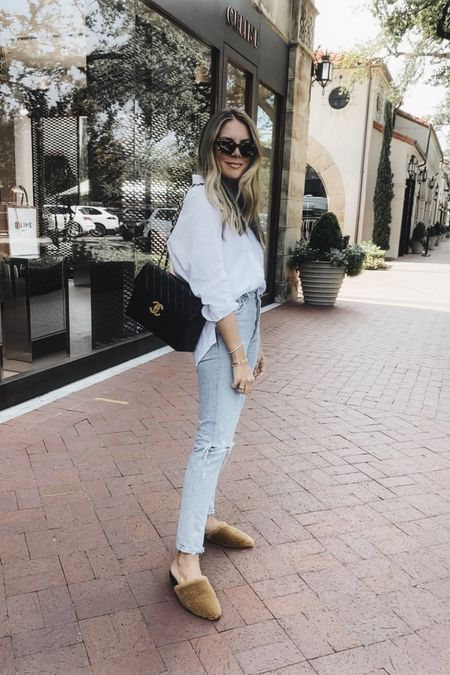 White button down, straight leg jeans and shearling mules 🖤