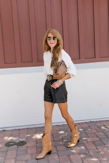 White knit, black faux leather shorts and tan cowboy boots  Aka FALL ready!!   #LTKshoecrush #LTKstyletip #LTKitbag