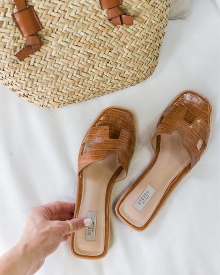 I'll be sharing a roundup of summer sandals on natalieyerger.com on Thursday, but here's a sneak peek! I have these Steve Madden sandals in tan and white and definitely recommend. They look more expensive than they are—they run a little narrow, so not ideal for walking all day, but perfect for the office, brunch, or date night. I got my true size!   cognac sandals, hermes oran sandals, croc sandals, sandals under 100, brown sandals, tan sandals  #LTKshoecrush #LTKSeasonal #LTKunder100