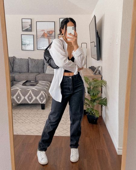 LOOK 5: How To Style a White Button Down - I went for a street style/tomboy vibe with this outfit. The baggy jeans and sneakers are more masculine yet there are still some feminine pieces like the purse and jewelry to help balance out the look.    Follow me on the LIKEtoKNOW.it shopping app to get the product details for this look and others   http://liketk.it/3gDZf #liketkit @liketoknow.it #LTKunder100 #LTKstyletip #LTKshoecrush