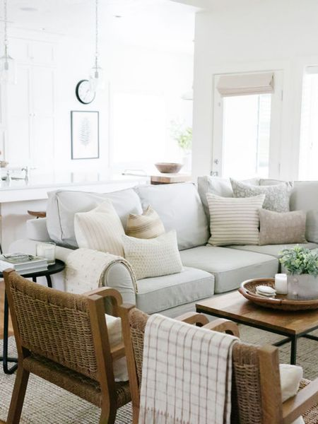 Summer decor in the living room. Neutrals, blush, cream and gray pillows mixed with woods and textures gives the living room a soft, summery look.    You can instantly shop my looks by following me on the LIKEtoKNOW.it shopping app http://liketk.it/3jGeo #liketkit @liketoknow.it #LTKunder50 #LTKunder100 #LTKhome @liketoknow.it.home